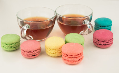 two cup of tea with macaroons