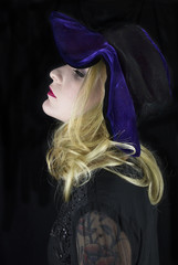 Young woman wearing floppy purple hat