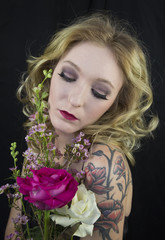 Pretty blond woman holding flowers