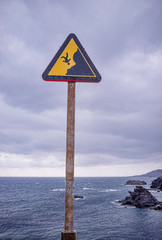 Warning sign on cliff