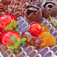 chocolate cake with strawberries and fruits, sweet background