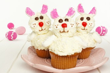 Cute spring bunny cupcakes on pink plate with Easter eggs