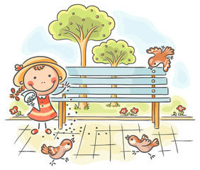Girl feeding sparrows in the park