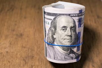Roll of One Hundred Dollar Bills