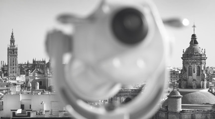 Binocular out of focus and Seville outdoors city view. Spain