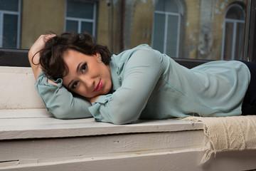 Beautiful girl sitting near window pane