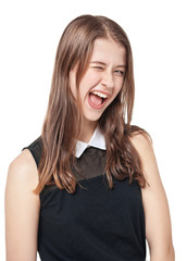 Young beautiful teenager girl winking isolated