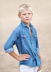 portrait of a little boy on the beach in summer