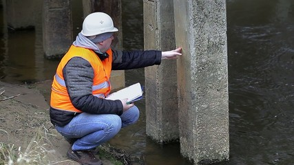 Engineer checking the bridge supports