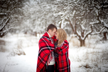 man and woman is heated under a blanket in winter
