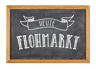 Schild mit der Beschriftung Heute Flohmarkt