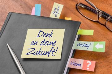 Terminkalender mit Haftnotiz - Denk an deine Zukunft
