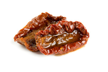 sun dried tomatoes with olive oil isolated on white