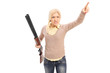 Angry woman holding a rifle and pointing with finger