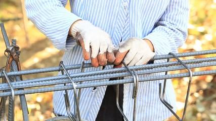 worker bending and bundle steel for construction job