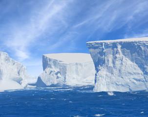 Antarctica giant blue iceberg floating