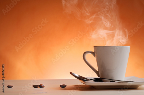 Canvas Cafe Cup of coffee with orange background front view