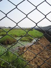 iron net fence on backdrop background