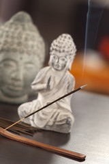 an incense on the table at home