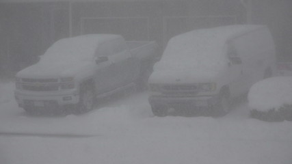 Snowing Hard on a Truck and Van