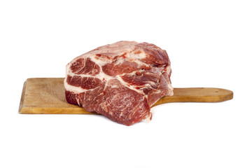 Raw pork meat on a rectangular board isolated
