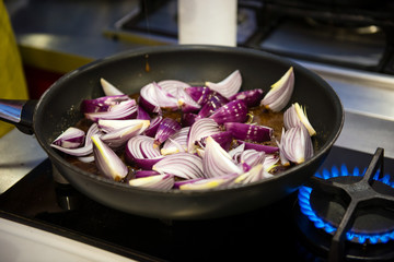 Steak sauce on the pan - red onion wedges, caramel and red wine