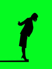 Silhouette of a woman close to fall down