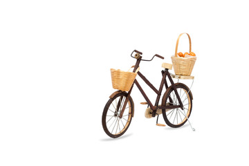 Wooden bicycle toy isolated on white with clipping path