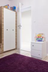 Soft violet carpet in child's room