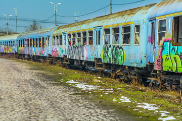 Abandoned train wagons vandalized near Grand Bridge.