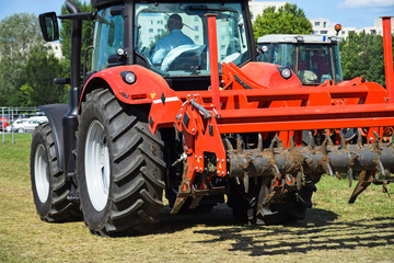 Tractor with plowing equipment