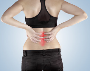 Woman with both palm around back to show pain and injury on back