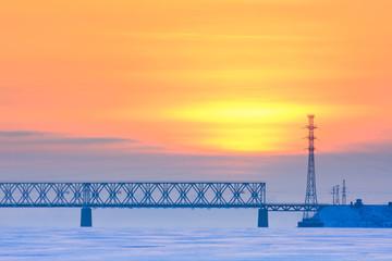 railway bridge over a frozen river