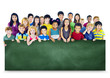 Multi-Ethnic Group Children Holding Blackboard Concept