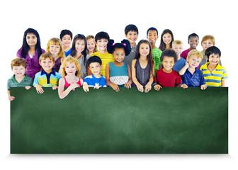 Multi-Ethnic Group Children Holding Blackboard Concept