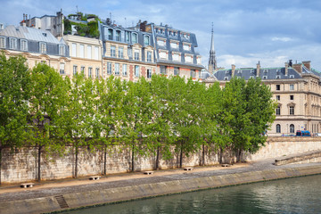Seine river embankment with trees and old houses