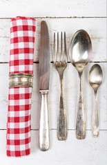 antique cutlery and towel on the white wooden table