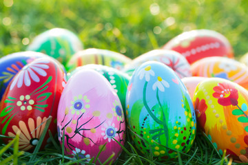 Hand painted Easter eggs on grass. Spring patterns art, unique.