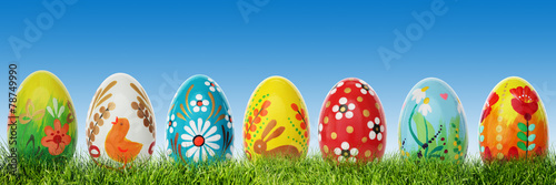Foto op Plexiglas Egg Hand painted Easter eggs on grass. Panorama, banner.