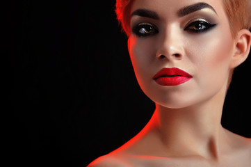 Beauty portrait of girl on black background with red