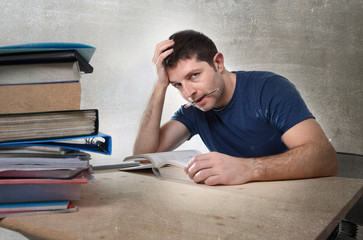 young stressed student studying exam in stress