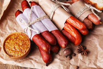 Assortment of thin sausages, and spices