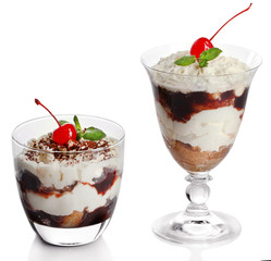 Tasty tiramisu dessert in glasses, isolated on white