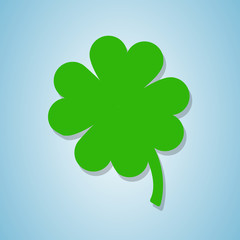 Green Clover flower isolated on blue background