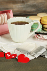 Heart shaped teabag tags, macaroons and cup of tea