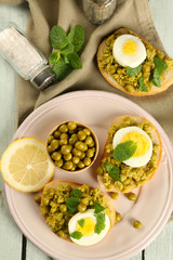 Sandwiches with green peas paste and boiled egg