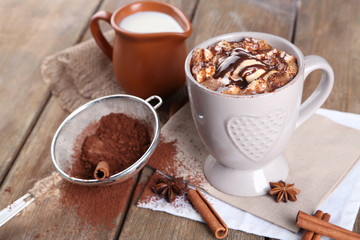 Cup of hot coffee with marshmallow and cup of milk with