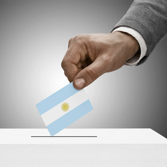 Black male holding flag. Voting concept - Argentina