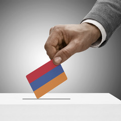 Black male holding flag. Voting concept - Armenia