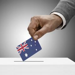 Black male holding flag. Voting concept - Australia